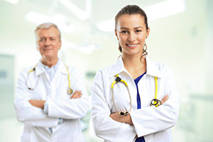 Male and female doctors smiling at the camera